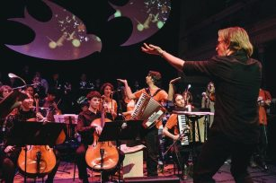 Bass player Doug conducts 'Oro Negro', a composition by the Transatlantic Chilean Folk Ensemble with whom we collaborated.